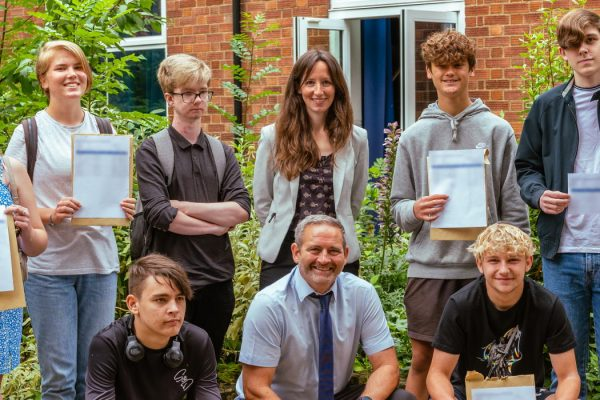 Students at SET Beccles on GCSE results day with (centre) Head of School Heidi Philpott.