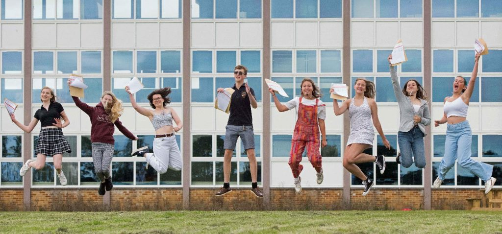 Students jumping for joy on GCSE results day at SET Saxmundham